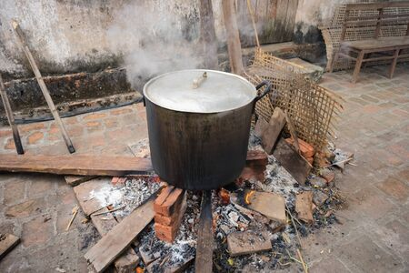 Big pot to cook Chung cake outdoor, square glutinous rice cake, Vietnamese lunar new year food