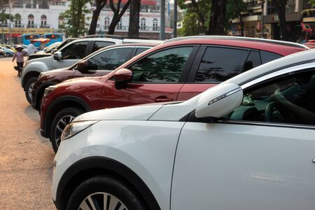 Parallel Cars parked on the urban street side