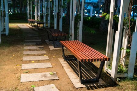 Wooden bench in the park at night Stock Photo