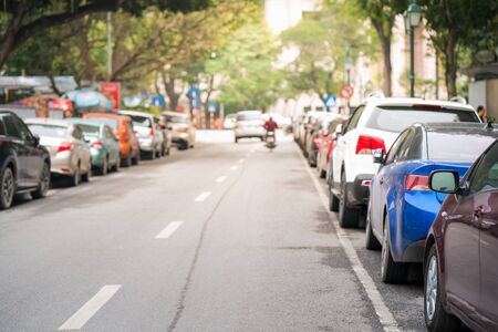 Cars parked on the urban street side Stock Photo
