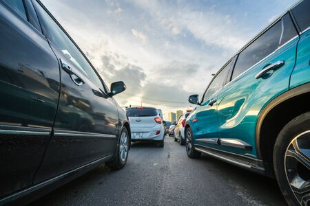 Cars on city street in traffic jam at rush hour 免版税图像