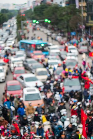 Blurred background of crowd of Vietnamese football fans down the street to celebrate the win after soccer, with a lot of Vietnamese flags raising high 版權商用圖片 - 130799176