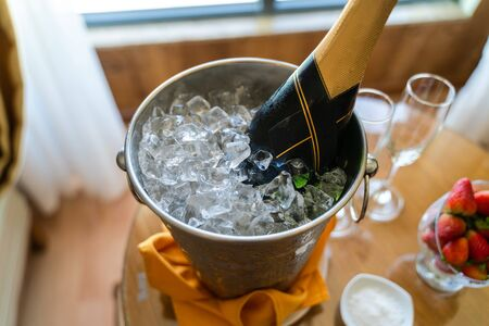 Ice bucket with bottle of chilled champagne