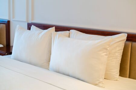 White soft pillows on a bed in hotel Фото со стока