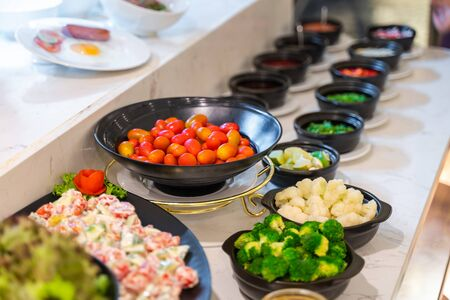 Salad bar with vegetables in the restaurant, healthy food Banco de Imagens