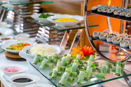 Fresh Asian spring rolls with shrimps, vegetables, fruit...on buffet table