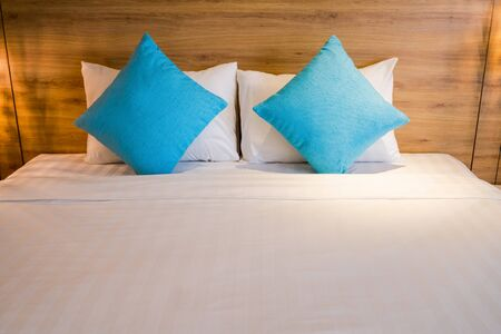 Blue soft pillows on a bed in hotel