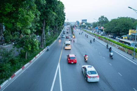 Blurred car traffic background in Hanoi street, Vietnam