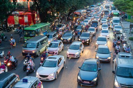 Blurred car traffic background at rush hour in Hanoi street, Vietnam