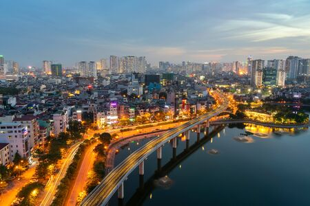 Hanoi cityscape during sunset period. Skyline view of Hanoi at Hoang Cau lake Zdjęcie Seryjne - 133359899