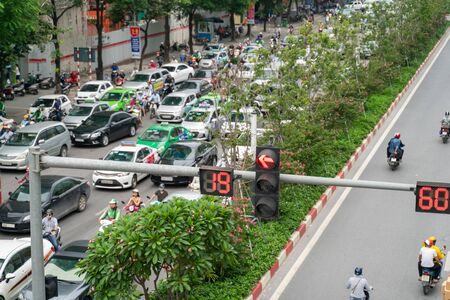 Traffic light with street traffic on background in Hanoi street