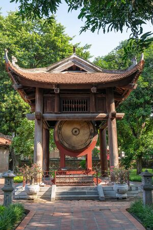 Square building hold a big sacred drum at The Temple of Literature (Van Mieu), the first national university in Hanoi Archivio Fotografico - 133360026