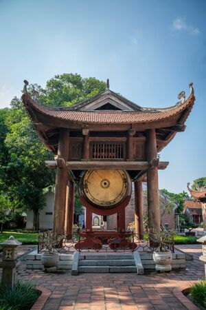 Square building hold a big sacred drum at The Temple of Literature (Van Mieu), the first national university in Hanoi Archivio Fotografico - 133360032