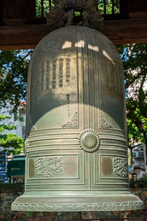 Big bell on side of Imperial Academy in Temple of Literature (Van Mieu), the first national university in Hanoi Archivio Fotografico - 133360054