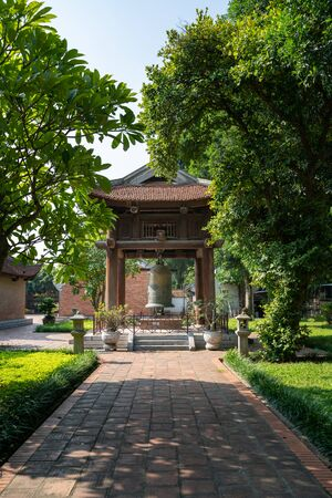 Square building holding a big bell on side of Imperial Academy in Temple of Literature (Van Mieu), the first national university in Hanoi Archivio Fotografico - 133360056
