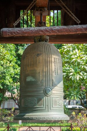 Big bell on side of Imperial Academy in Temple of Literature (Van Mieu), the first national university in Hanoi Archivio Fotografico - 133360061