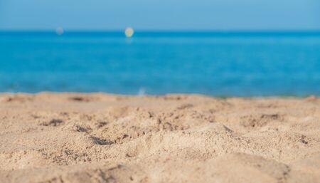 Tropical sea beach with sand, ocean and blue sky