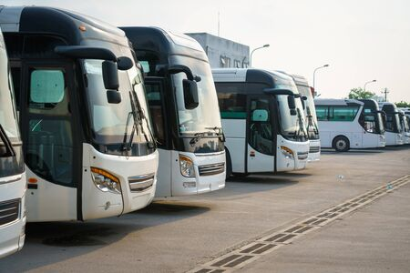 City buses in the parking lot at the bus station