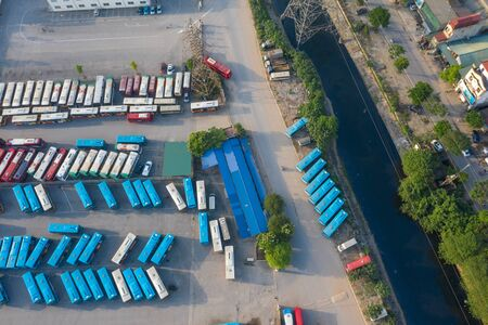 Aerial view of city buses in the parking lot at the bus station