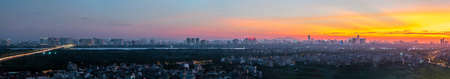 Panorama cityscape of Hanoi skyline at Vinh Tuy bridge over Red river during sunset time Stockfoto