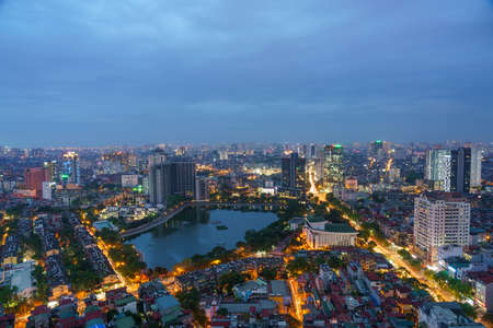 Cityscape of Hanoi skyline at Thanh Cong lake, Dong Da district during sunset time in Hanoi city, Vietnam in 2020