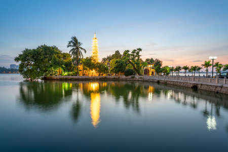 Tran Quoc pagoda, the oldest Buddhist temple in Hanoi, at twilight. The famous destination travel in Hanoi