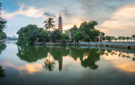 Tran Quoc pagoda during sunset time, the oldest temple in Hanoi, Vietnam. Hanoi cityscape.