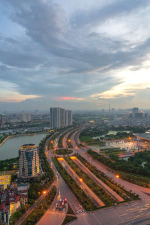 Hanoi skyline cityscape during sunset period at intersection Khuat Duy Tien - Tran Duy Hung st in Cau Giay district in 2020