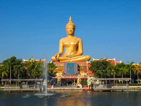 singburi: BIG GOLDEN BUDDHA IN SINGBURI, THAILAND WITH FOUNTAIN Stock Photo