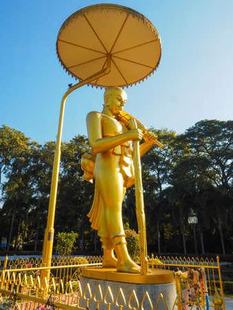 singburi: STATUE OF GOLDEN BUDDHIST MONK WALKING