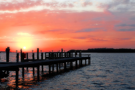 Sunrise over Sarasota Bay, Florida with a dock in the foreground