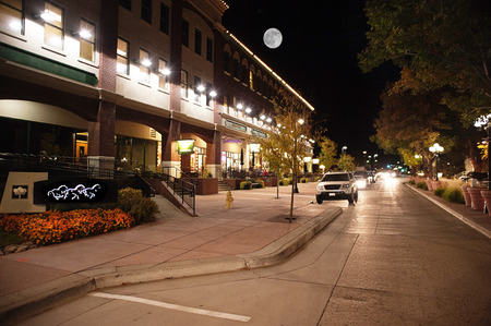 moonrise over main street in Parker, CO Editorial