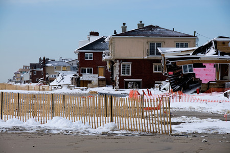 surge: Six months after Hurricane Sandys storm surge destroyed countless homes along the Rockaway coastline, the area is still rebuilding. Stock Photo