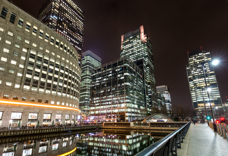 wharf: Financial district Canary Wharf in London by night Stock Photo