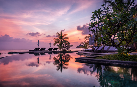 Reflections of a Maldivian sunset in pool water Stock Photo