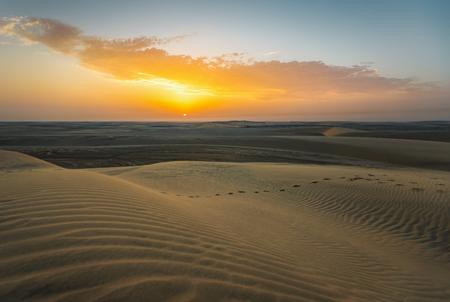 Sunset over the desert of Qatar, near the capital Doha