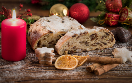 German Christmas Stollen decorated with cinnamon and oranges for the festive advent season