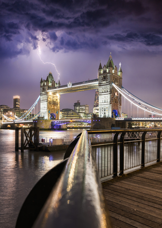 The Tower Bridge in London, United Kingdom, during a stormy night with thunder and lightning Stock Photo