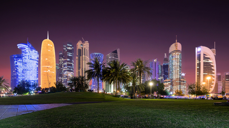 The skyline of Doha, Qatar, by night with starry sky seen from the Sheraton Park