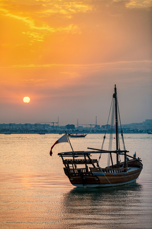 Traditional Dhow boat at the coast of Doha during sunset, Qatar