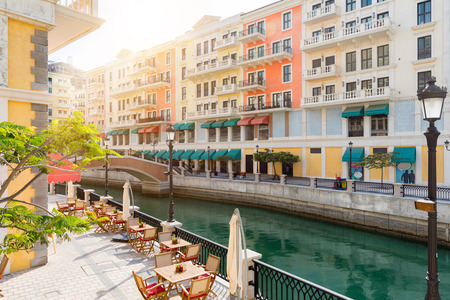 Afternoon atmosphere in the Qanat Quartier at the Pearl in Doha, Qatar Stock Photo