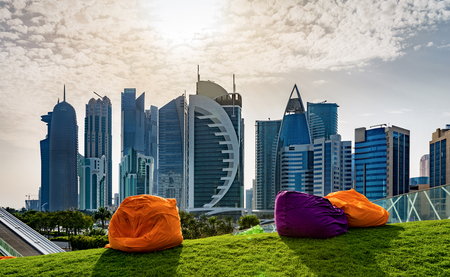 Bean Bags in a park at the front of the skyline of Doha, Qatar Stock Photo