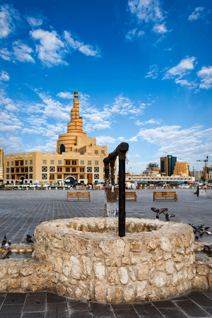 Old well replica in front of the Souq Waqif in Doha, Qatar Stock Photo