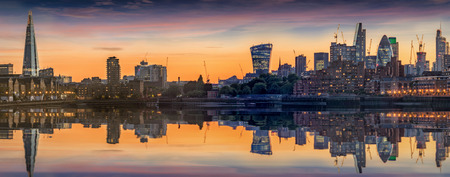 The new skyline of London, United Kingdom, after sunset seen from Canary Wharf