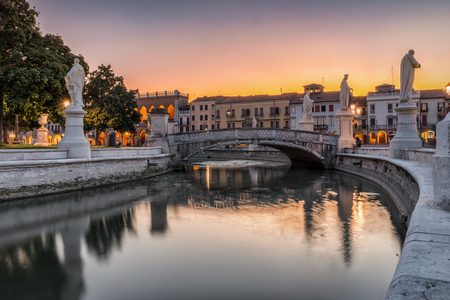The Prato della Valle square with magnificent statues in Padova, Italy, during sunset