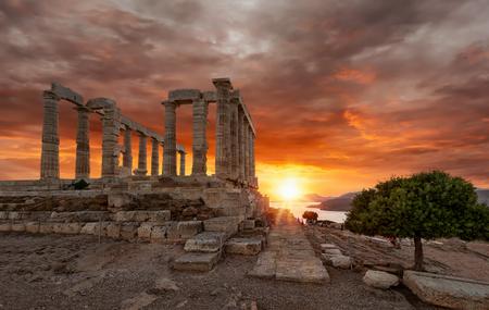 Cloudy sunset over the Temple of Poseidon at Sounion, Attica, Greece Фото со стока