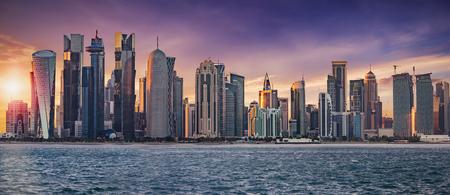 The skyline of Doha, Qatar, on a cloudy sunset