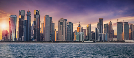 The skyline of Doha, Qatar, on a cloudy sunset