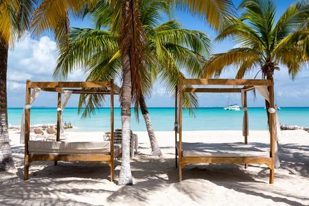 Luxurious sunbeds on a tropical beach in the caribbean, Mexico Stock Photo