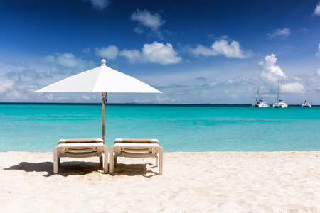 Sunbeds and umbrella on a beach in the caribbean, Isla Mujeres, Yukatan, Mexico